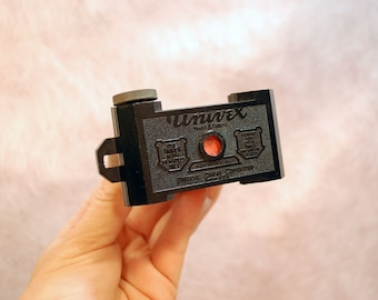 vintage Univex Model A Camera with exposed film in camera bakelite body lomography