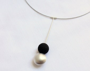 Magma Necklace made of Matte sterling silver, simple and contemporary design to wear all day, long  and lightweight.