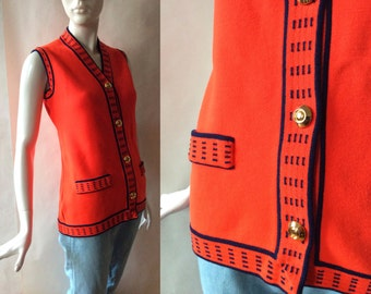 1960's / early 1970's William Silva of San Francisco sweater vest, rich deep red orange with navy blue trim and goldtone buttons, medium