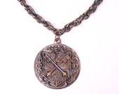 vintage copper shield pendant necklace coat of arms royal medallion medal hippie bohemian 1970s mid century modern retro gift