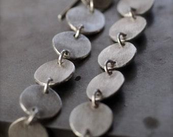 Super long, super chic flowing fine silver disc earrings