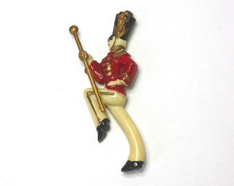 Vintage 40s Drum Major Brooch Articulated Celluloid Plastic Majorette w Moving Gold Baton