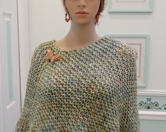 KNITTED PONCHO:  Green/Beige, Shawl/cape, handknitted, Champagne/ ivory fun fur trim, including removable, butterfly brooch