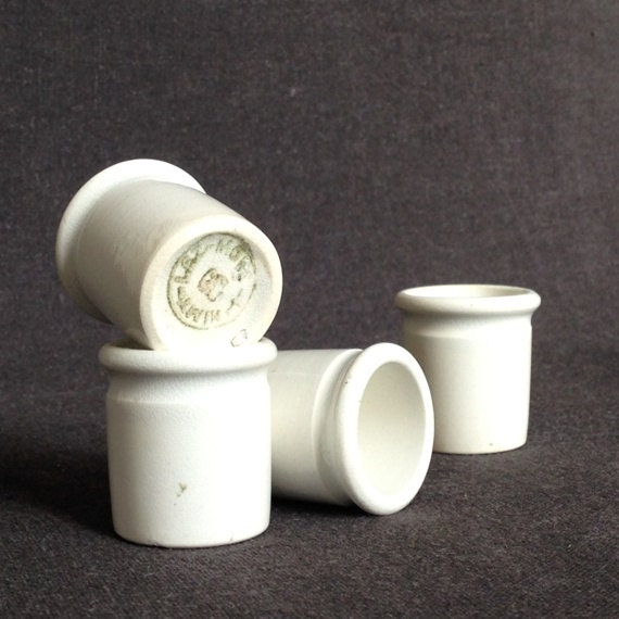 Four white vintage laboratory scientist porcelain cups. Set of rescued small crucibles.