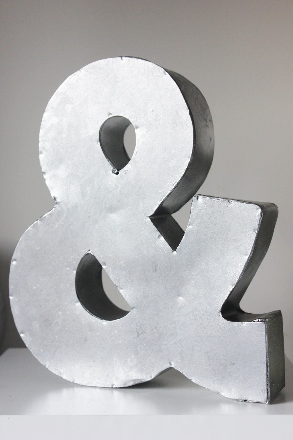 large metal ampersand letter sign and zinc steel initial