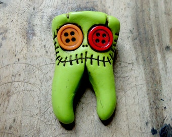 Smiling molar monster. Human teeth brooch with two roots and buttons in his eyes. Any color. Brooch, keychain, pendant or magnet (choose)