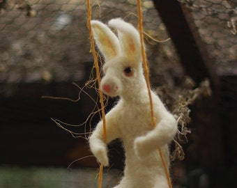 Needle felted rabbit on the swing, soft sculpture