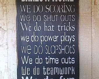 Wooden Sign In This Home .. We do Hockey personalized 10 inch by 20 inch tall hockey sign with family name included at the top