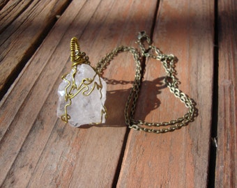 Super pale clear raw smoky quartz wrapped in aged brass wire