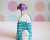 Mini Purple Bird on a Blue House