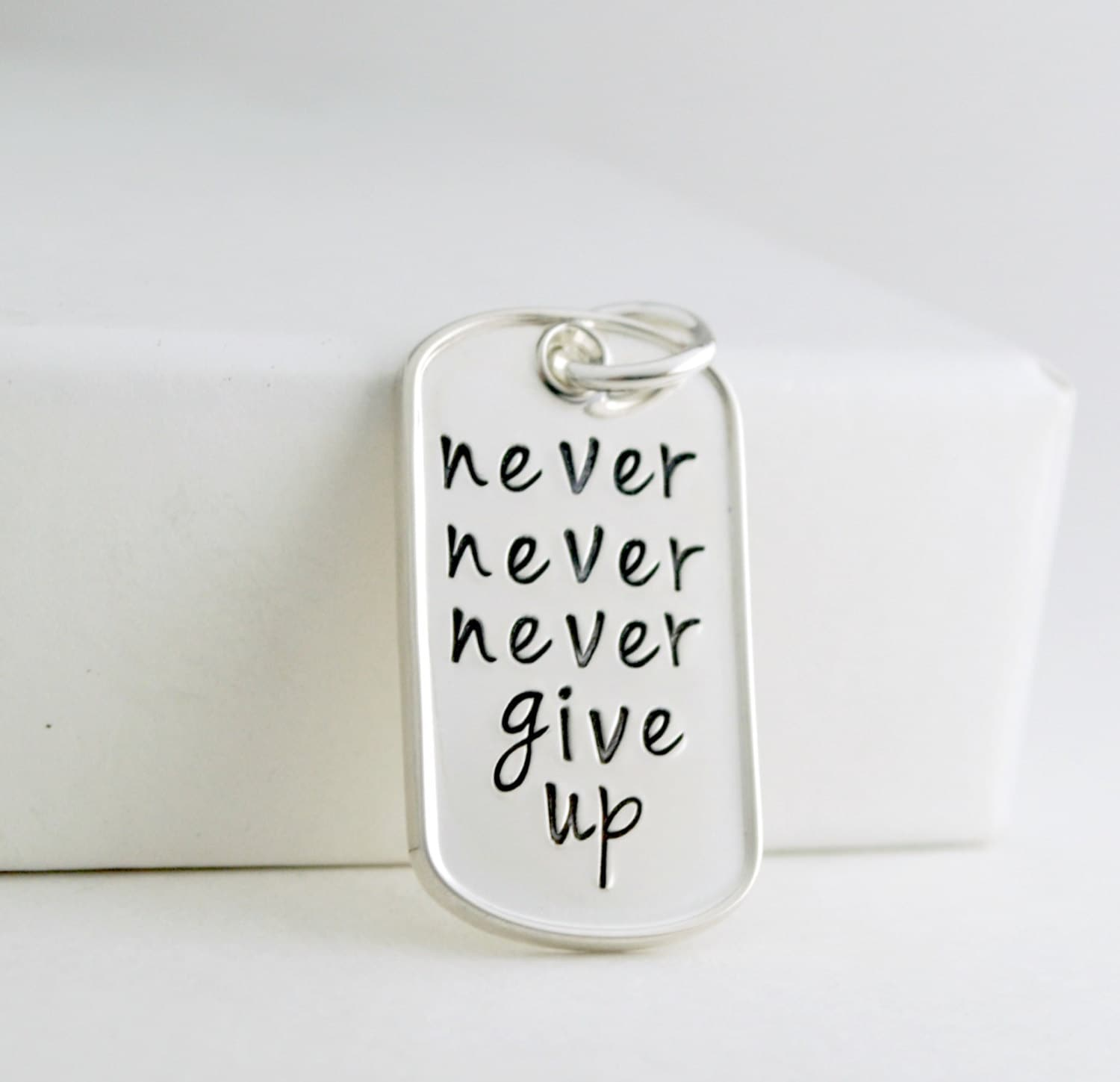 never never never give up pendant tag sted