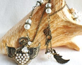 Pocket watch pendant, bronze pearl winged pocket watch adorned with glass pearl beads and bronze steampunk charms