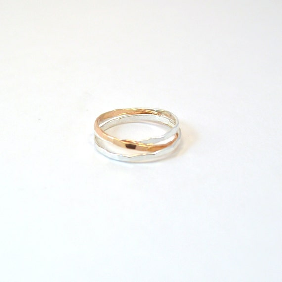 Two Tone Interlocking Rings. Gold and Silver Hammered Rolling Rings.