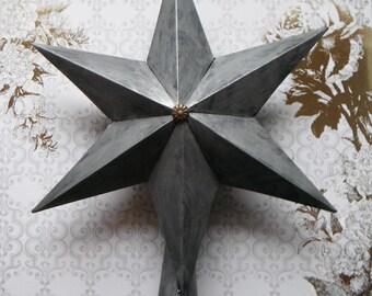 Industrial Paper Star Tree Topper. In Faux Metal