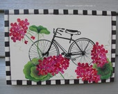 GERANIUMS AND A BICYCLE
