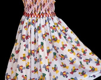 Hand-smocked cotton sun-dress, age 4 to 5, Christmassy coloured teddies on white background