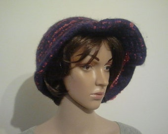 Asymmetric felted hat, a dark purple with a dark pink