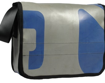 A4 Messenger bag made from upcycled truck tarps and seat belt webbing