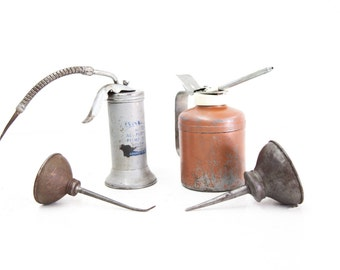 Group of Four Oil Antique Cans