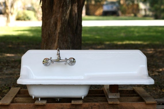 kitchen sink with drainboard and backsplash rustic vintage 1952 cast iron porcelain backsplash by 9585