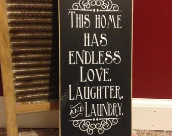 "This Home has Endless Love, Laughter and Laundry 12"" x 5.5""  Wooden Sign"