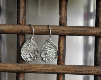 Fine Silver Dangle Earrings With Delicate Petals: who doesn't like flowers?
