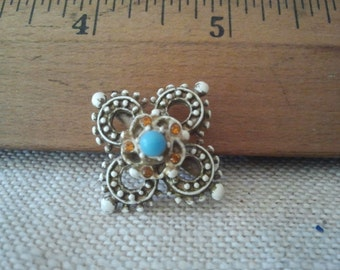 Vintage costume jewelry brooch.