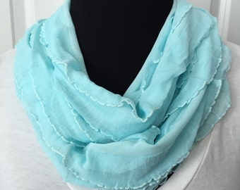 Light blue ruffle infinity scarf! Lightweight and airy! Not bulky! Beautiful spring/summer color of light blue or aqua! Great necklace scarf