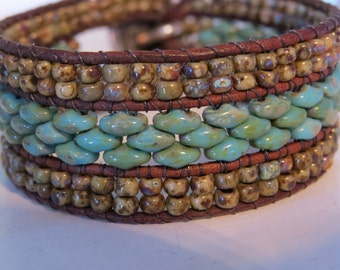 Western style, turquoise superduo beads and brown variegated seed beads, three row cuff, brown leather, handmade, silver buffalo button!