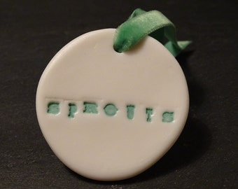 Hand Crafted Porcelain 'Sprouts' Christmas Decoration with festive Green Velvet Ribbon by Doe&Day.