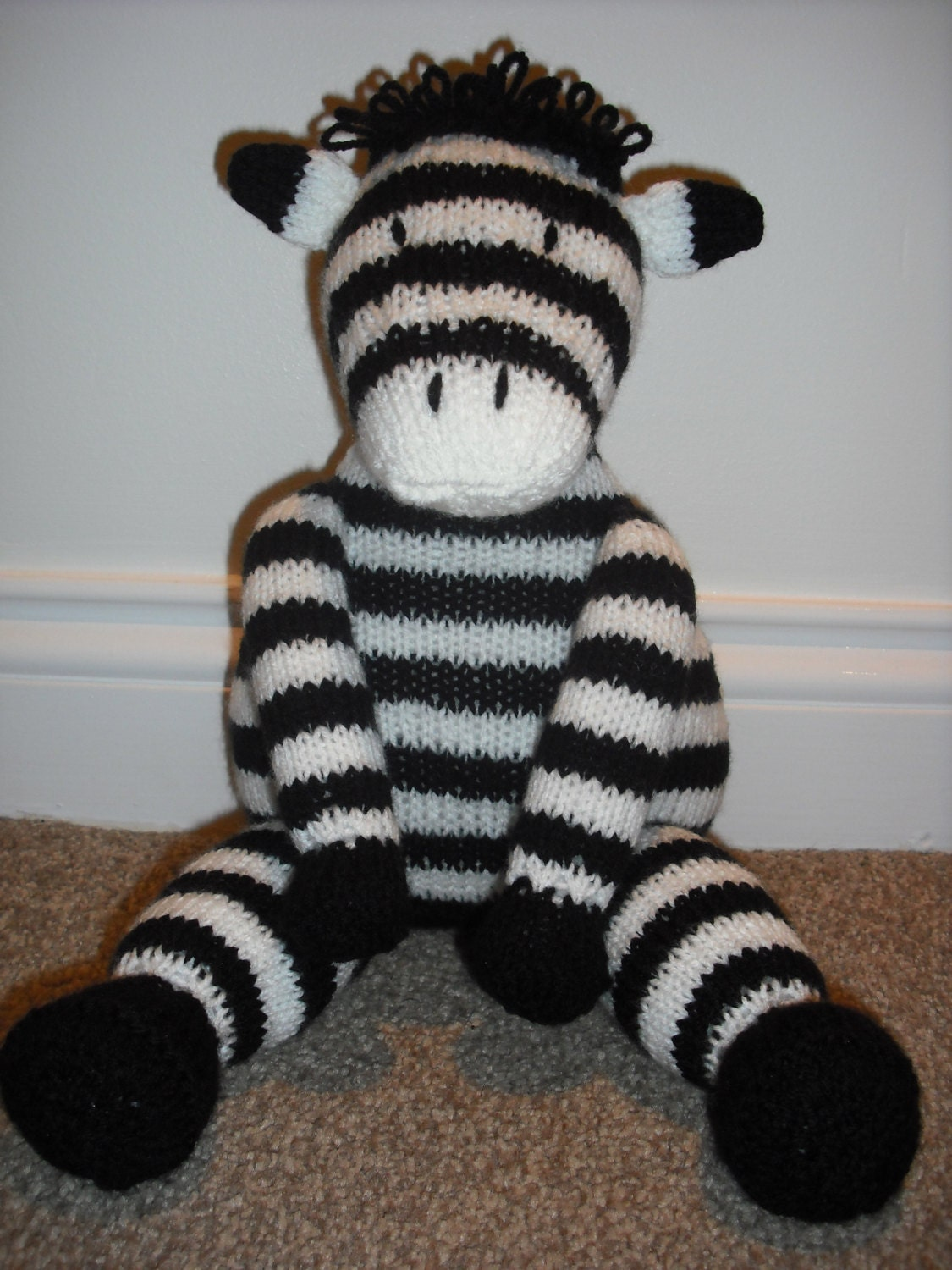 Zebra Hand Knitted Toy Made from a Sarah Keen pattern