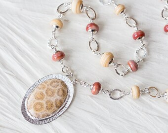 Pastel Floral Pattern Agatized Fossil Coral Necklace, oval sterling silver metalwork bezel set cabochon pendant, SRA lampwork necklace