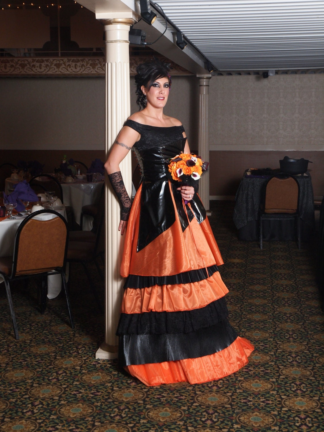 chandeliers pendant lights On black and orange wedding dresses