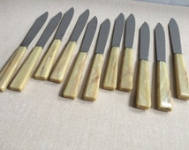 Vintage French Faux Blond Horn Dinner Knives | set of 11 | inox, stainless steel blades w/ tan, ivory marbleized handles | Made in France