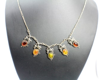 Amber in Silver Necklace with Grape Designs and Yellow Resin Stones Wrapped up in Sterling Silver with Silver Leaves and Light Chain