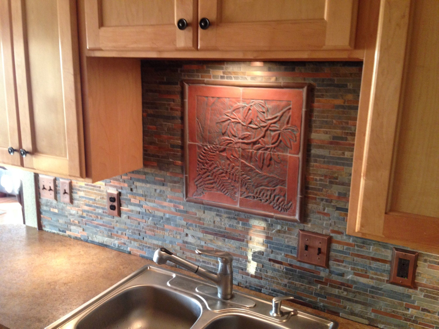 craftsman style carved tile woodland scene for backsplash
