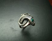 Elegant Sterling Silver snake ring with emerald and diamonds