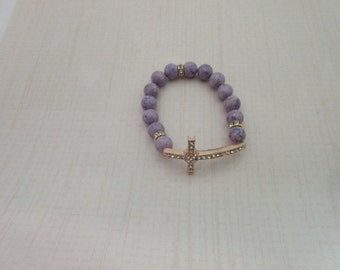 Violet Riverstone Bracelet with a sideway Rose Gold Cross