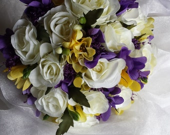 Beautiful Bridal Wedding Bouquet in Ivory Roses with Purple, Yellow Freesia & Purple Trachelium, Finished with Organza and Ribbon