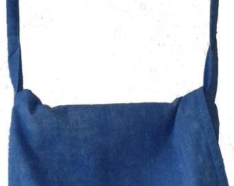 blue messenger bag with  featured dark blue lining