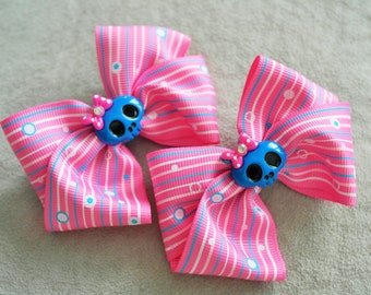 Pair of Blue Skeleton pink Hair Bow Clips