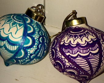 Pair of hand-decorated ceramic Christmas ornaments