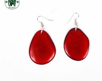 Tagua, earrings. dark red