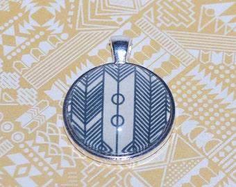 Comic arrow pendant