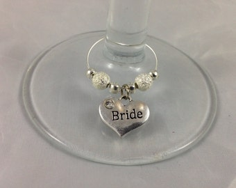 Wedding wine glass charms. Top table decoration in a choice of colours to match your theme.