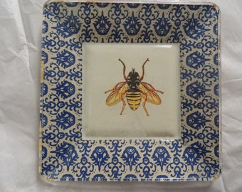 Vintage bumble bee print decoupaged on glass plate