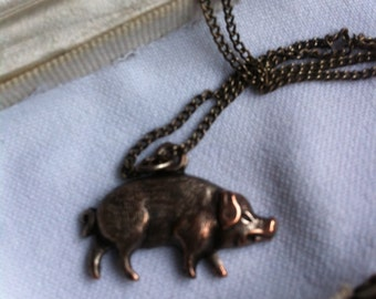 Pig pendant necklace in bronze. Vintage retro