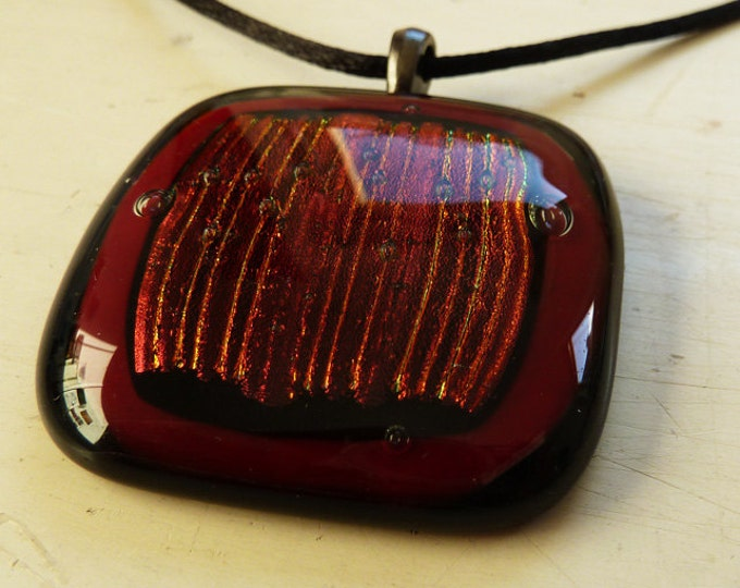 Cherry red and black dichroic fused glass pendant.