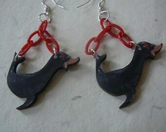 seal earrings statement