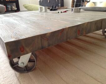 vintage handmade wood coffee table  with industrial wheels